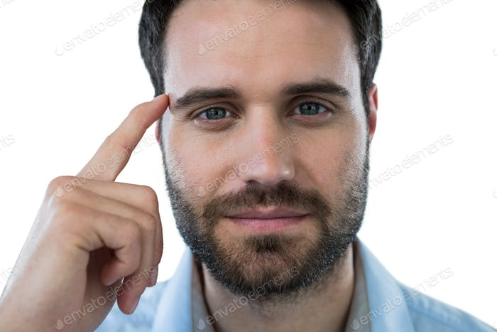Man with finger pointing to head