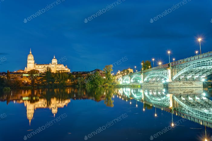 The Cathedral of Salamanca and the river Tormes at night