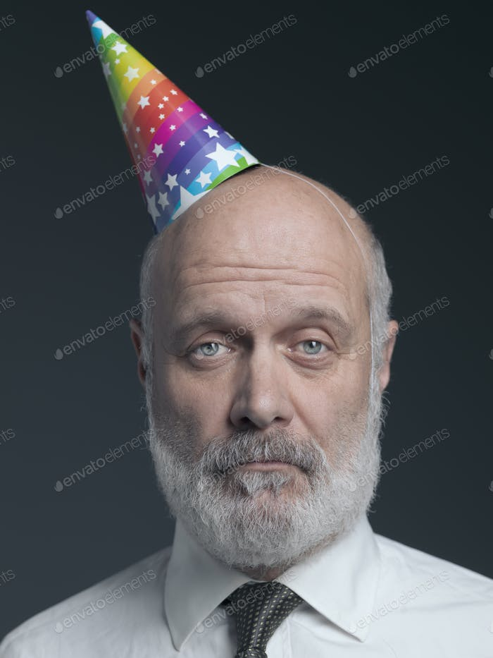 Funny senior bald man with party hat