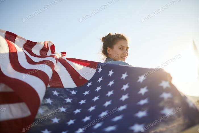 Pretty woman with waving flag