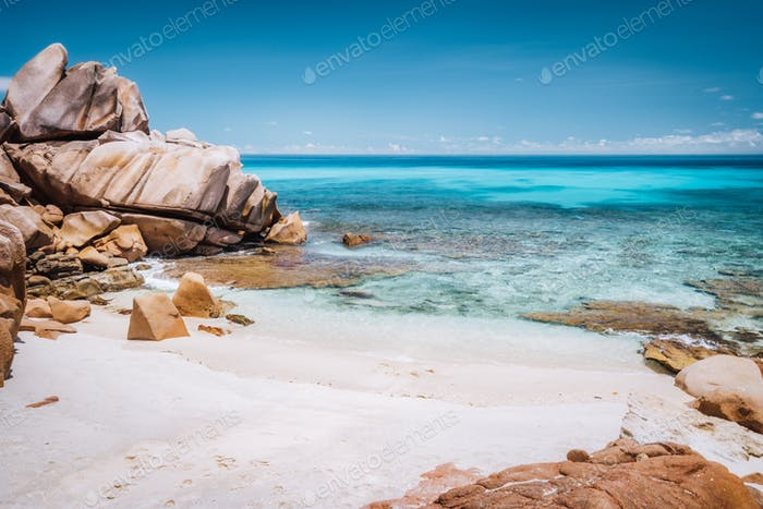 La Digue, Seychelles. Tropical exotic hidden beach with granite boulders and blue lagoon