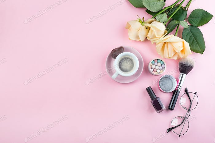 Workplace mockup with glasses and accessories on pink background top view. Flat lay with coffee copy