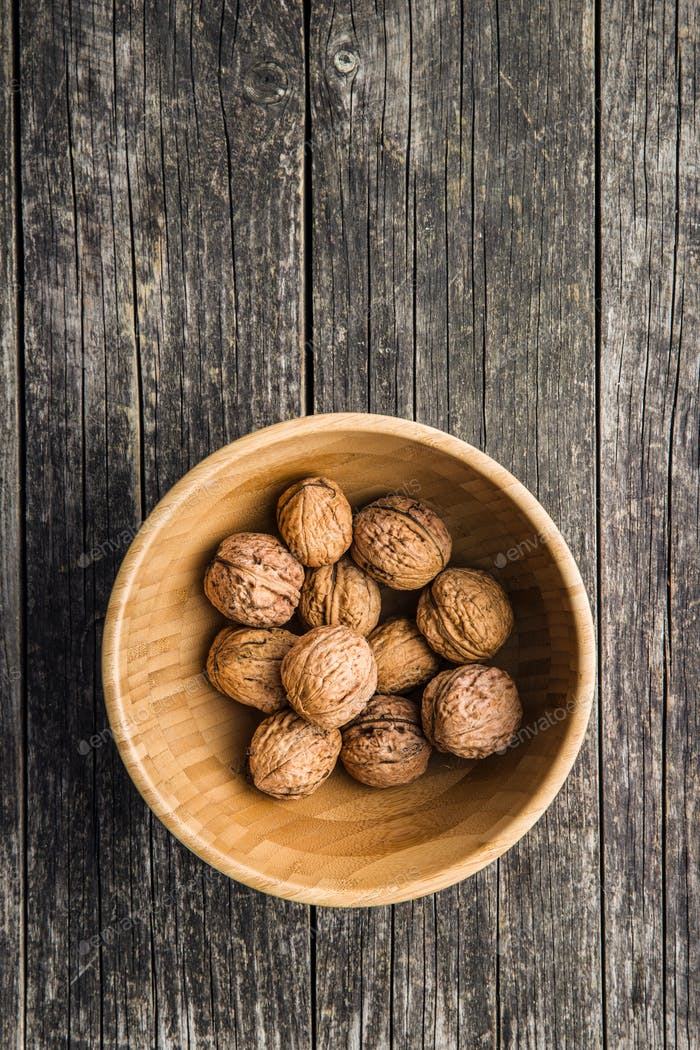 Tasty dried walnuts in bowl.