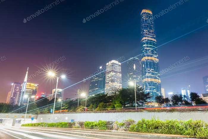 light trails with modern city at night