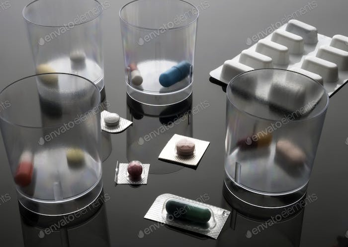 Different dosage medication in hospital, conceptual image, horizontal composition