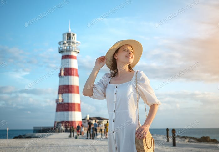 Smiling woman on the background of a beacon