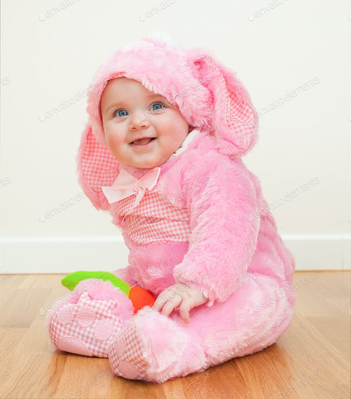 Pink cute baby in costume easter bunny
