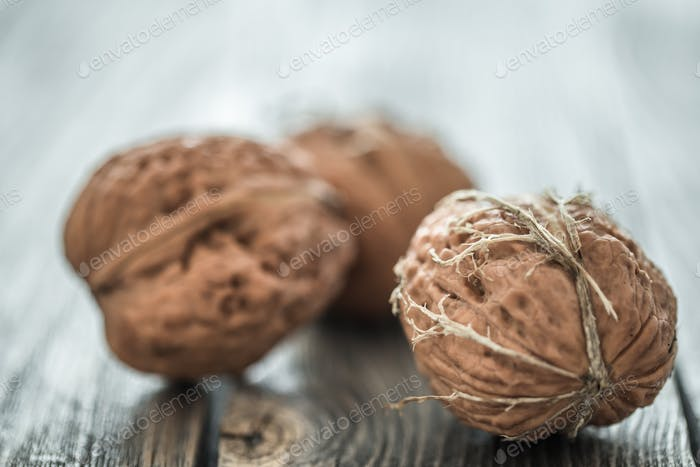 Walnut lies on a wooden background , close-up .