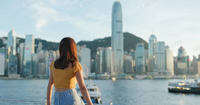Woman look at the city view in sunset time
