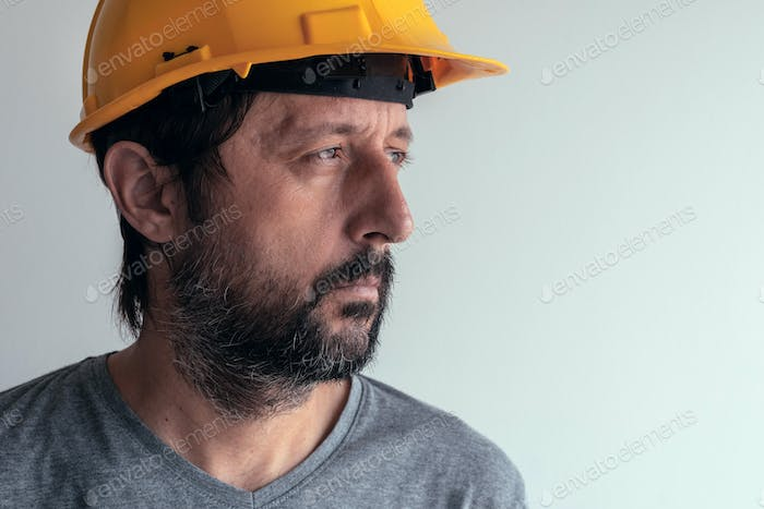 Portrait of serious thoughtful construction engineer