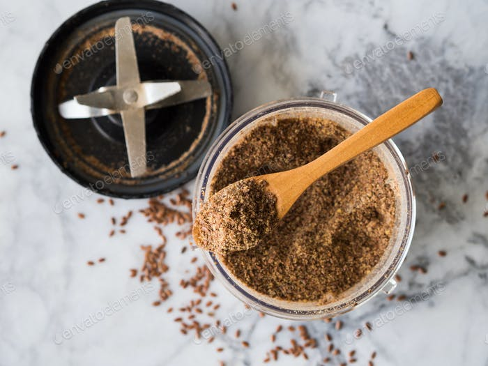 Blended Flax seeds in blender glass