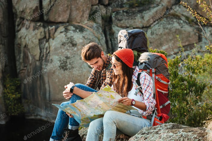 Young adventure couple with map