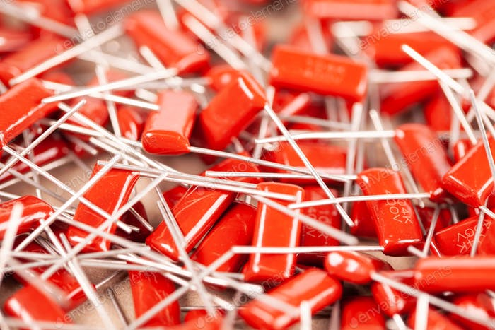 Close-up of a bunch of red capacitors