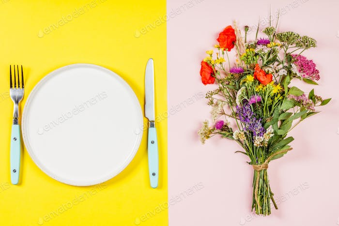 Wild flower bouquet and plate, flat lay, top view