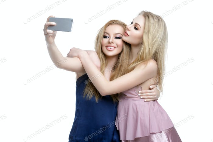 Two beautiful girls making selfie