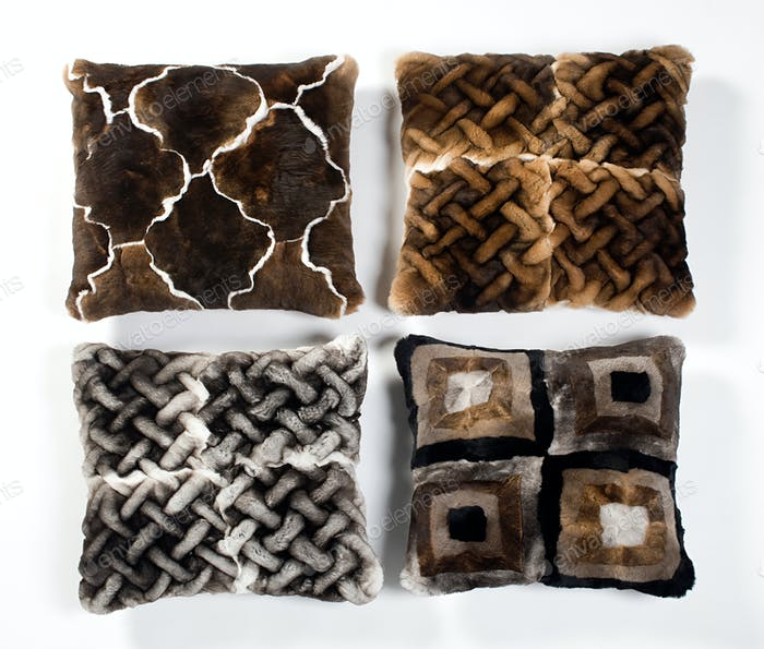 Four fur pillows with different designs