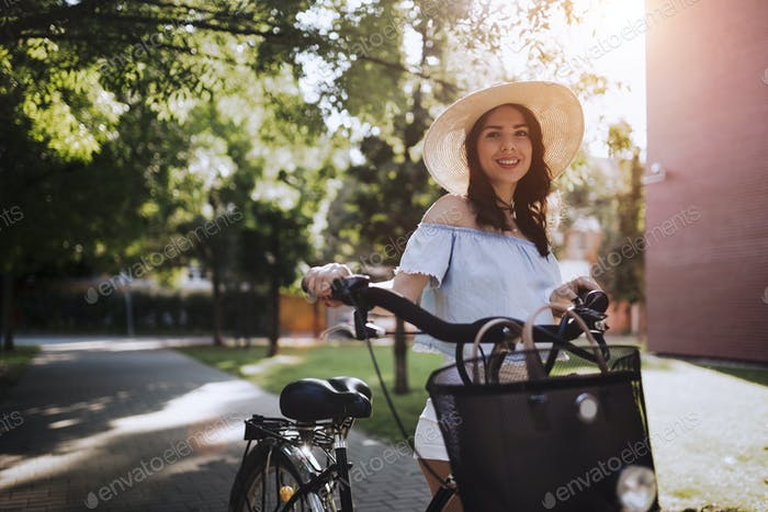 Portrait of beautiful woman enjoying time on bicycle