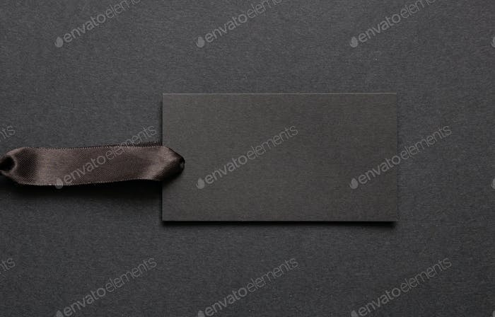 Black recycled price card against black background