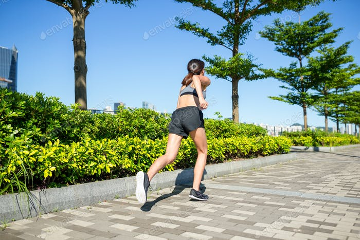 Woman running at outdoor park