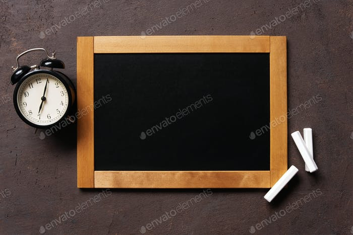 Blank Chalkboard and Alarm Clock
