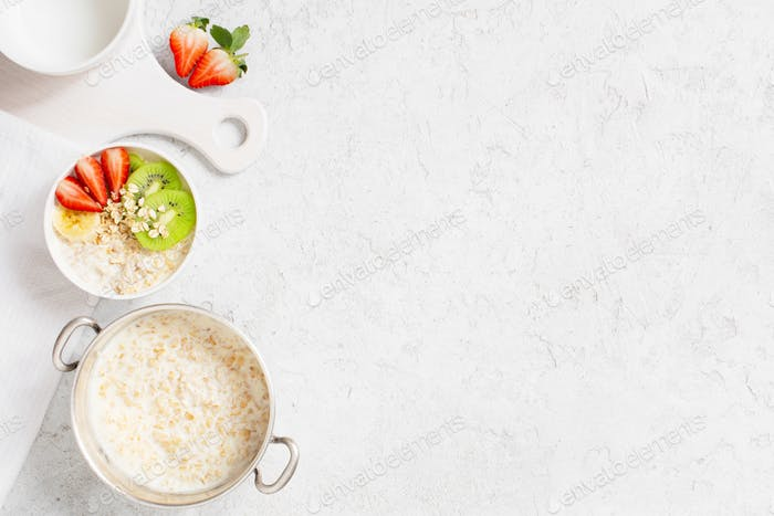 White Background with Oatmeal and Fruits