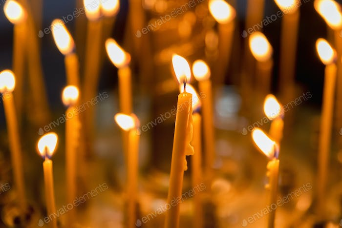Close up candles burning in a church