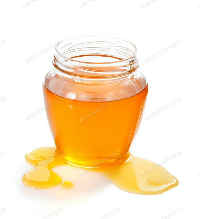 glass jar of honey and drop
