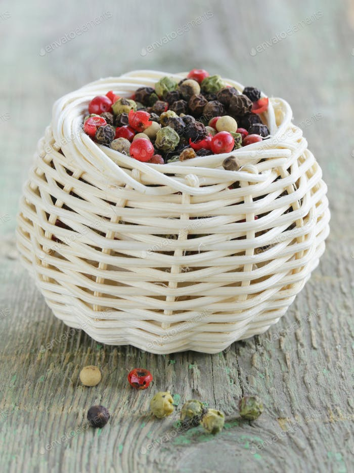 Colorful Peppercorn in Wicker Bowl
