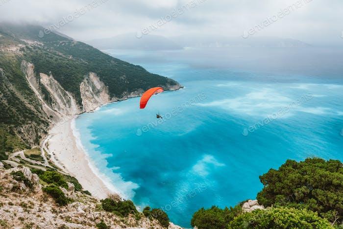 Summer season activity. Glider flying over beautiful Myrtos beach. Kefalonia island, Greece. Amazing