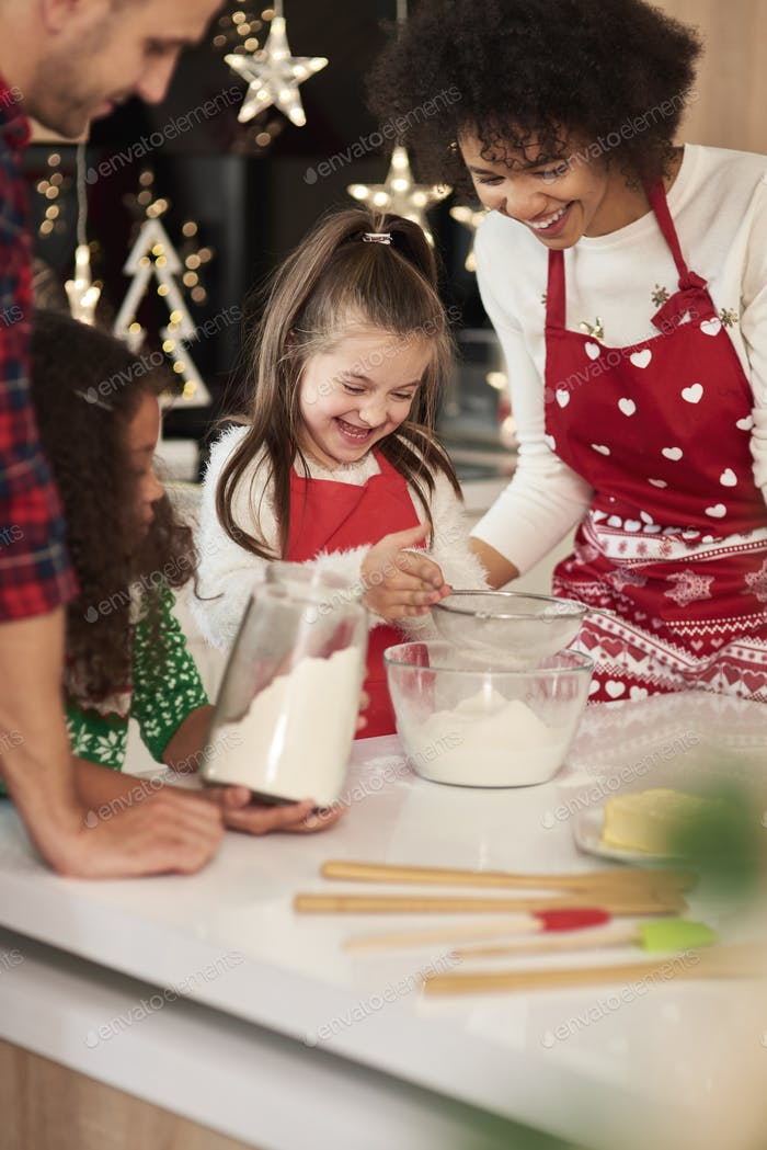 Happy family baking cookies for Christmas