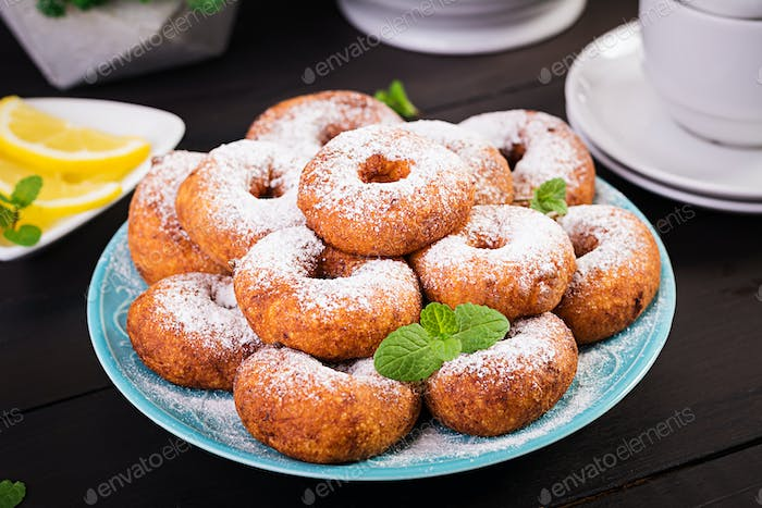 Brunch or lunch. Homemade donuts sprinkled with powdered sugar.