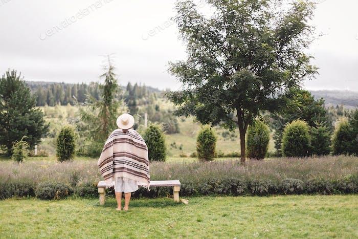 Bohemian woman enjoying vacation in mountains