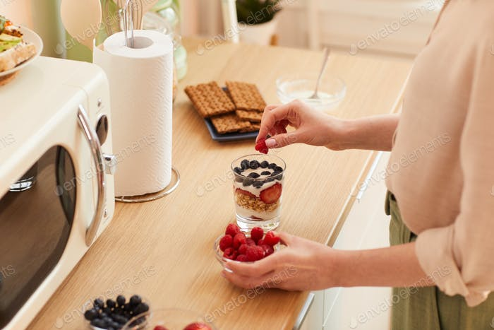 Woman Making Cup Dessert in Kitchen