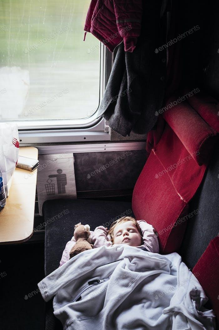 Baby girl sleeping in train