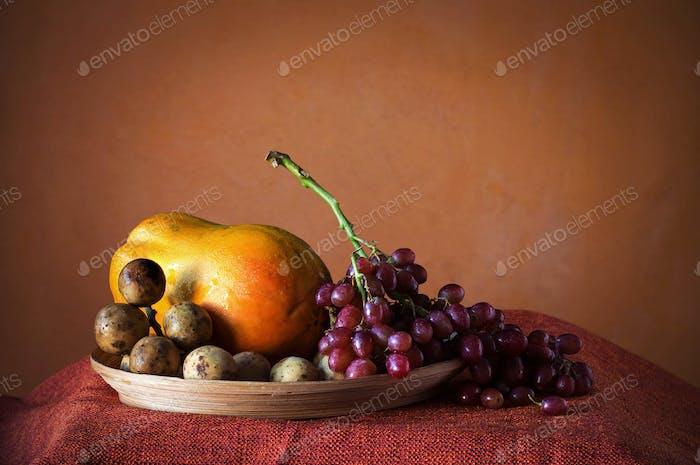 grapes and papaya on a tray