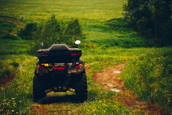 ATV Quad Bike in wild nature landscape
