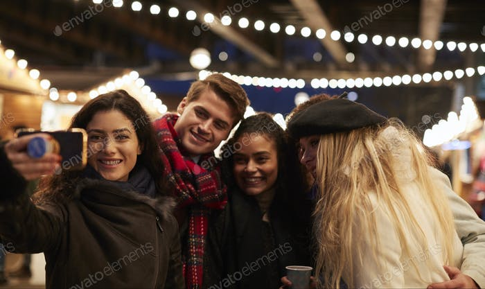 Thumbnail for Young Friends Posing For Selfie At Christmas Market