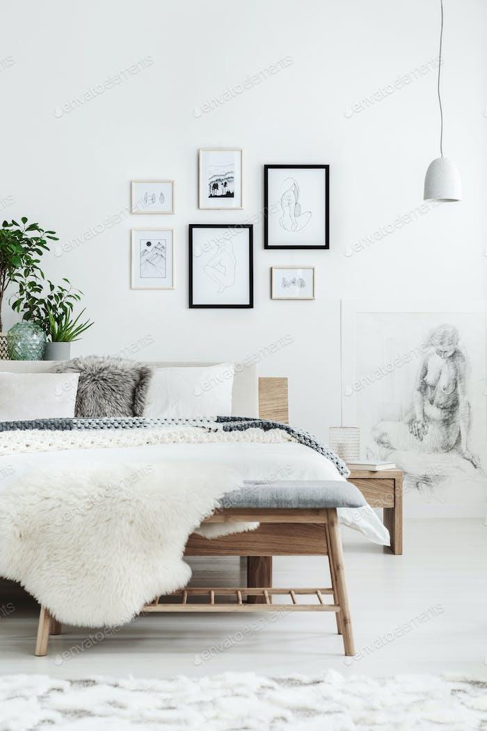 Drawings gallery in bright bedroom