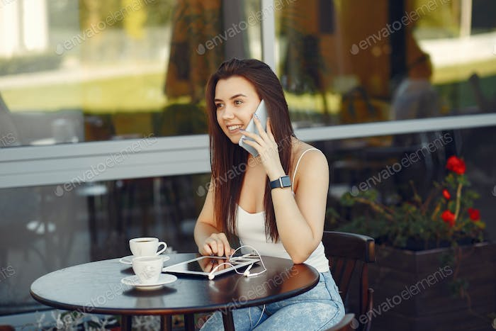 Businesswoman with tablet working in a cafe