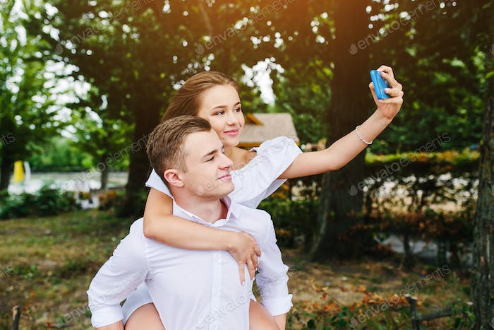 Beautiful young couple makes selfie