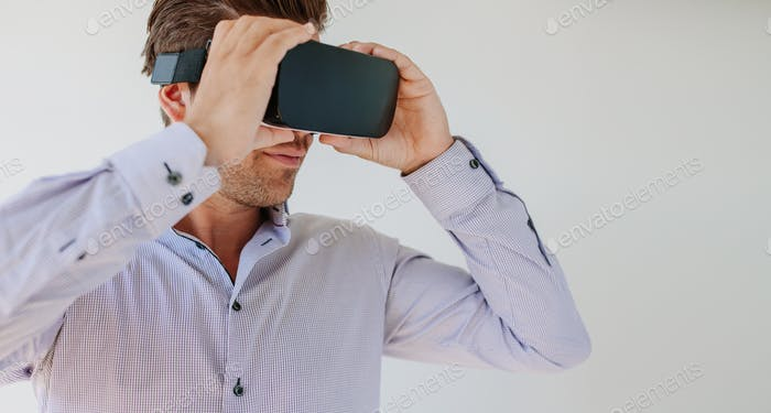 Man wearing virtual reality goggle