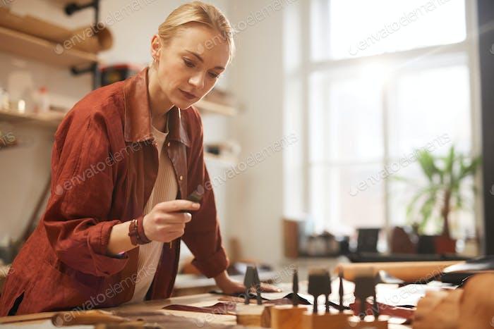 Craftswoman Choosing Stitching Chisel