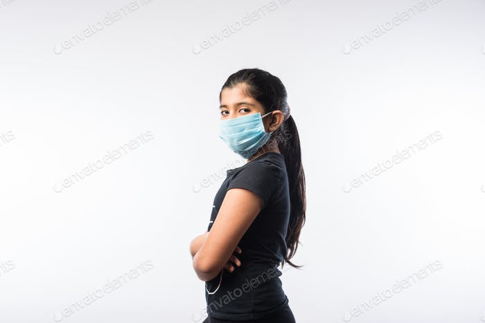Indian or Asian Girl Child wearing Face Mask