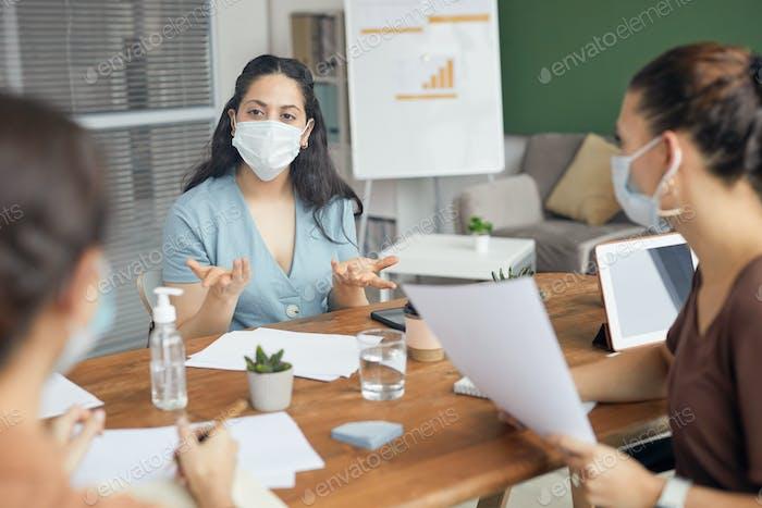 Businesswomen Wearing Masks in Meeting