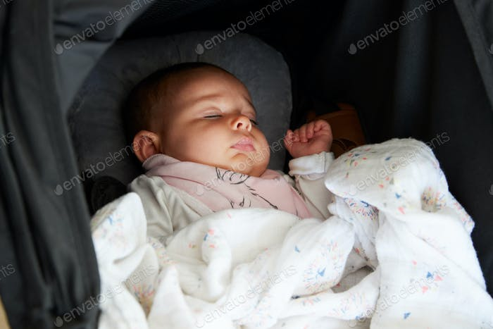 Close Up Of Baby Girl Asleep In Detachable Seat