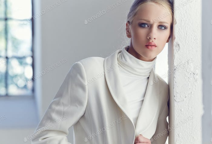 Portrait of fashionable blond girl.