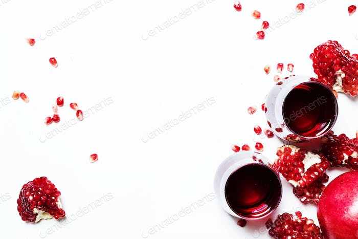 Fresh pomegranate juice in glass on white background