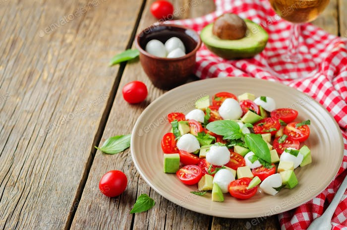 Avocado mozzarella tomato Basil salad