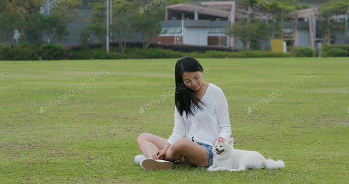 Woman play with her dog at park