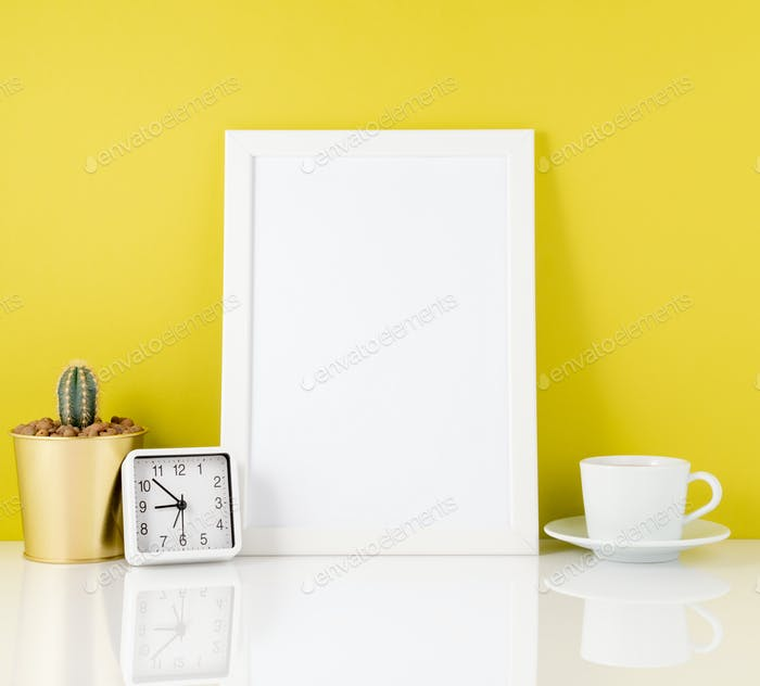 Blank white frame, clock, succulent,mug with tea or coffee again